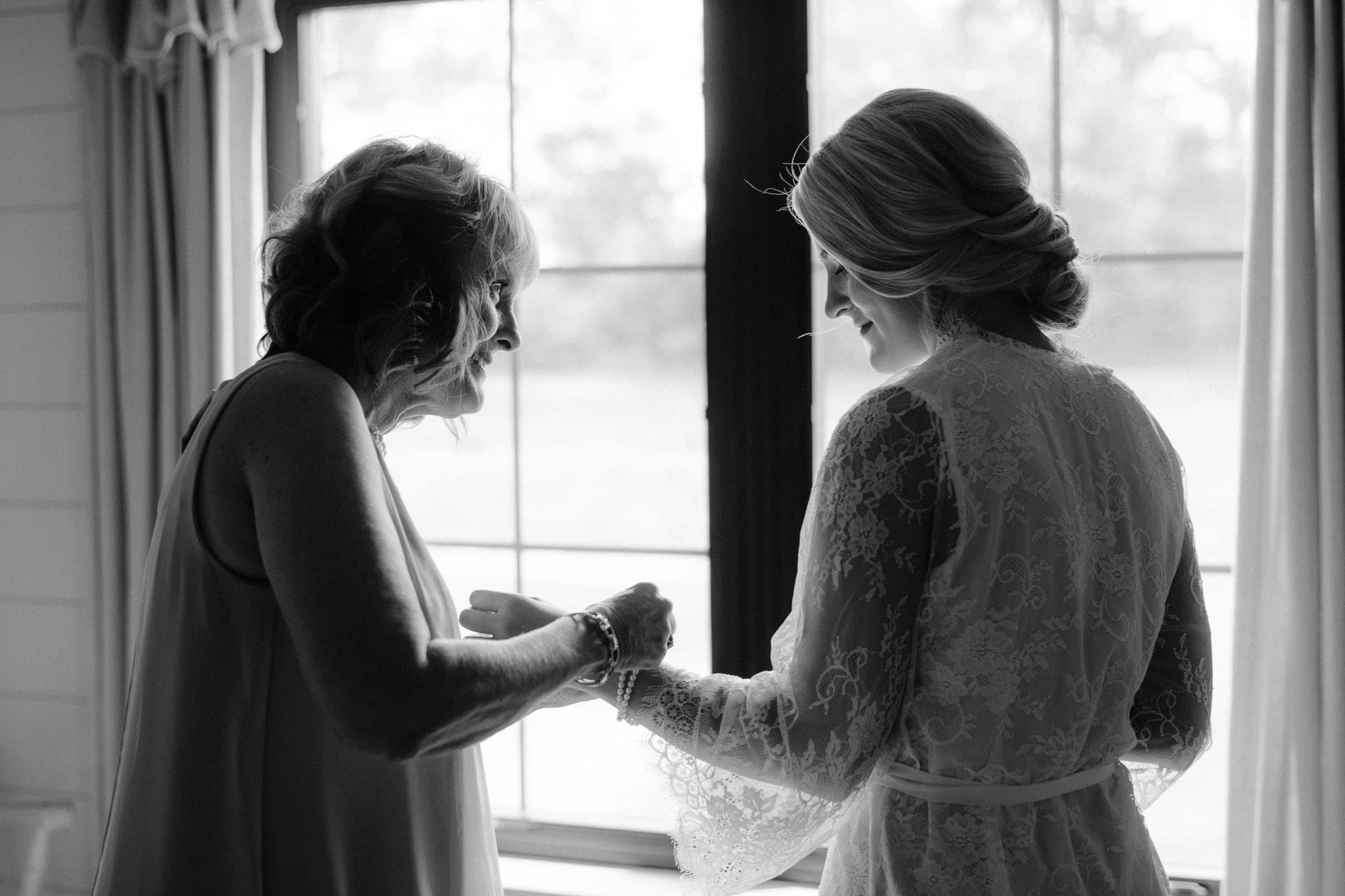bride and mother getting ready photos