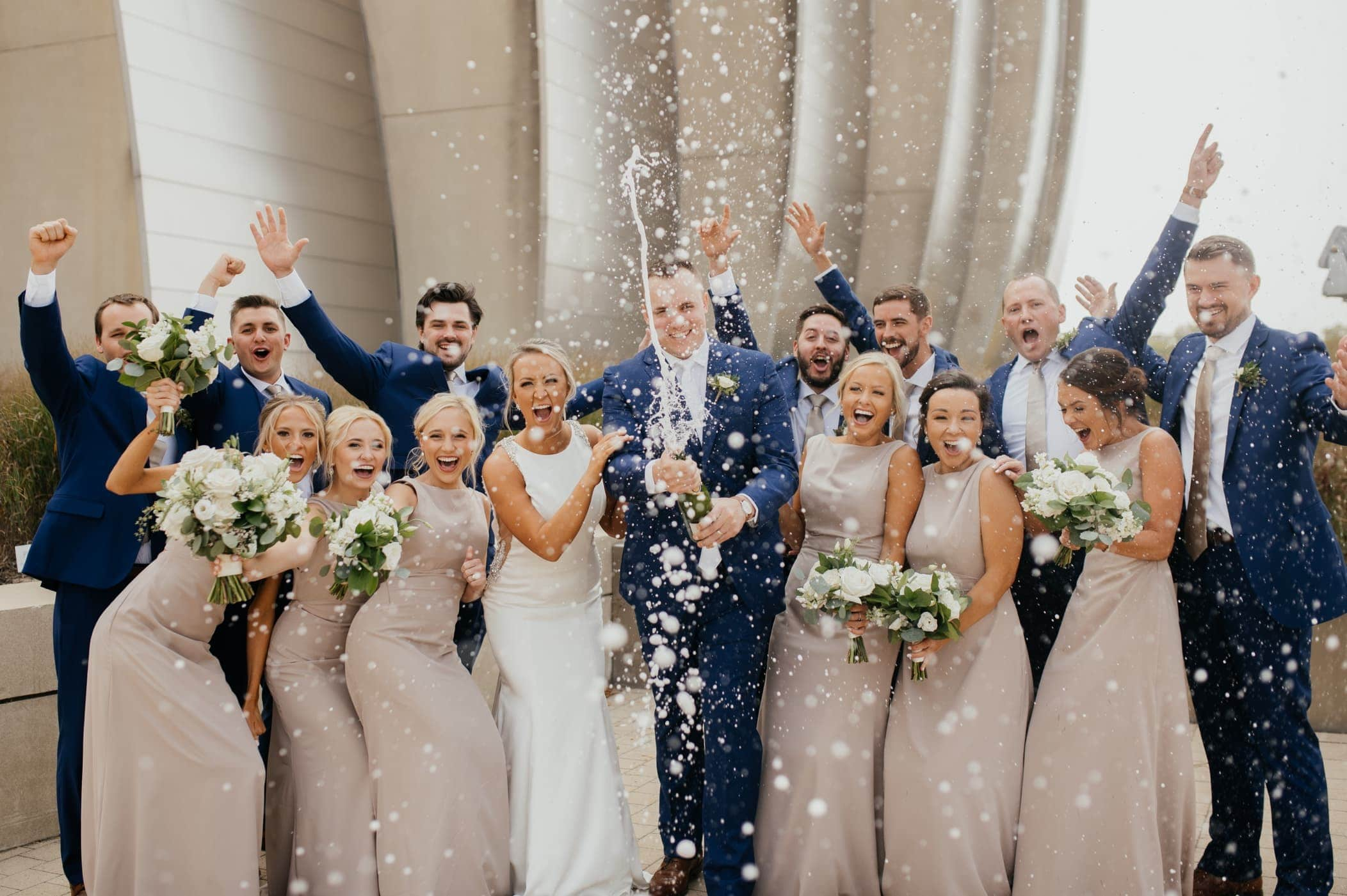 bridal part popping champagne at kauffman center