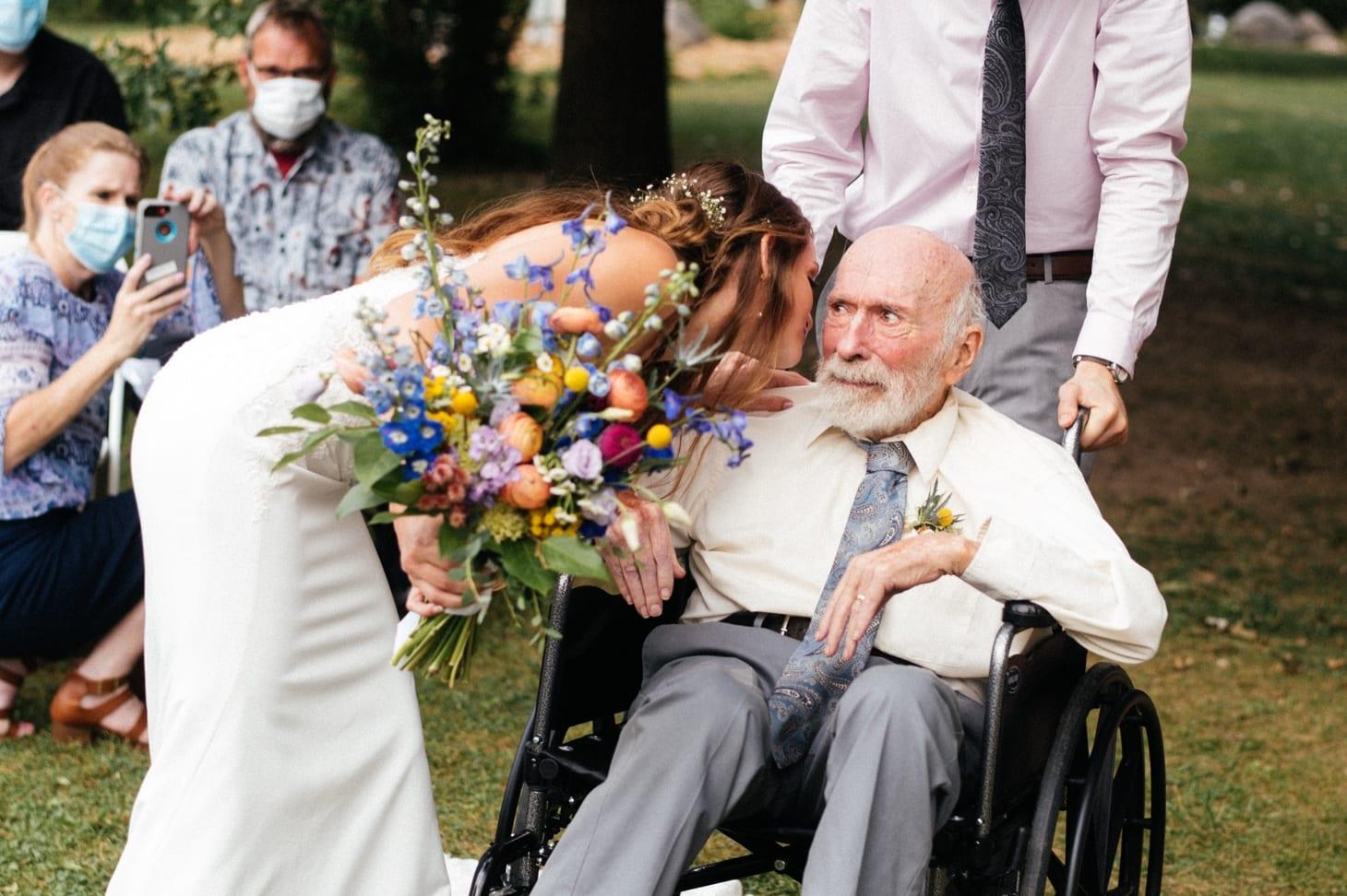bride kisses her father iowa city wedding photos