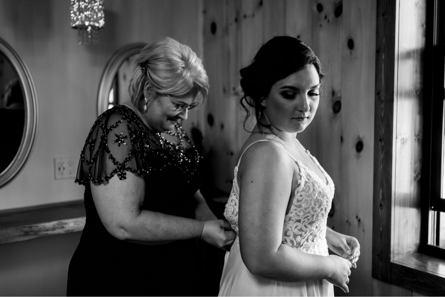 bride getting dressed at country lane lodge