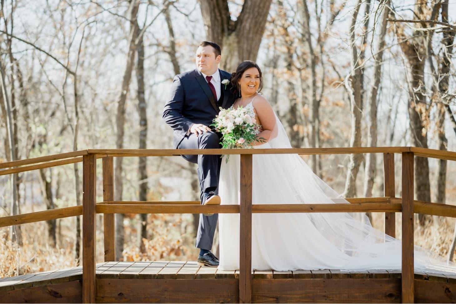 couples portrait on bridge adel iowa