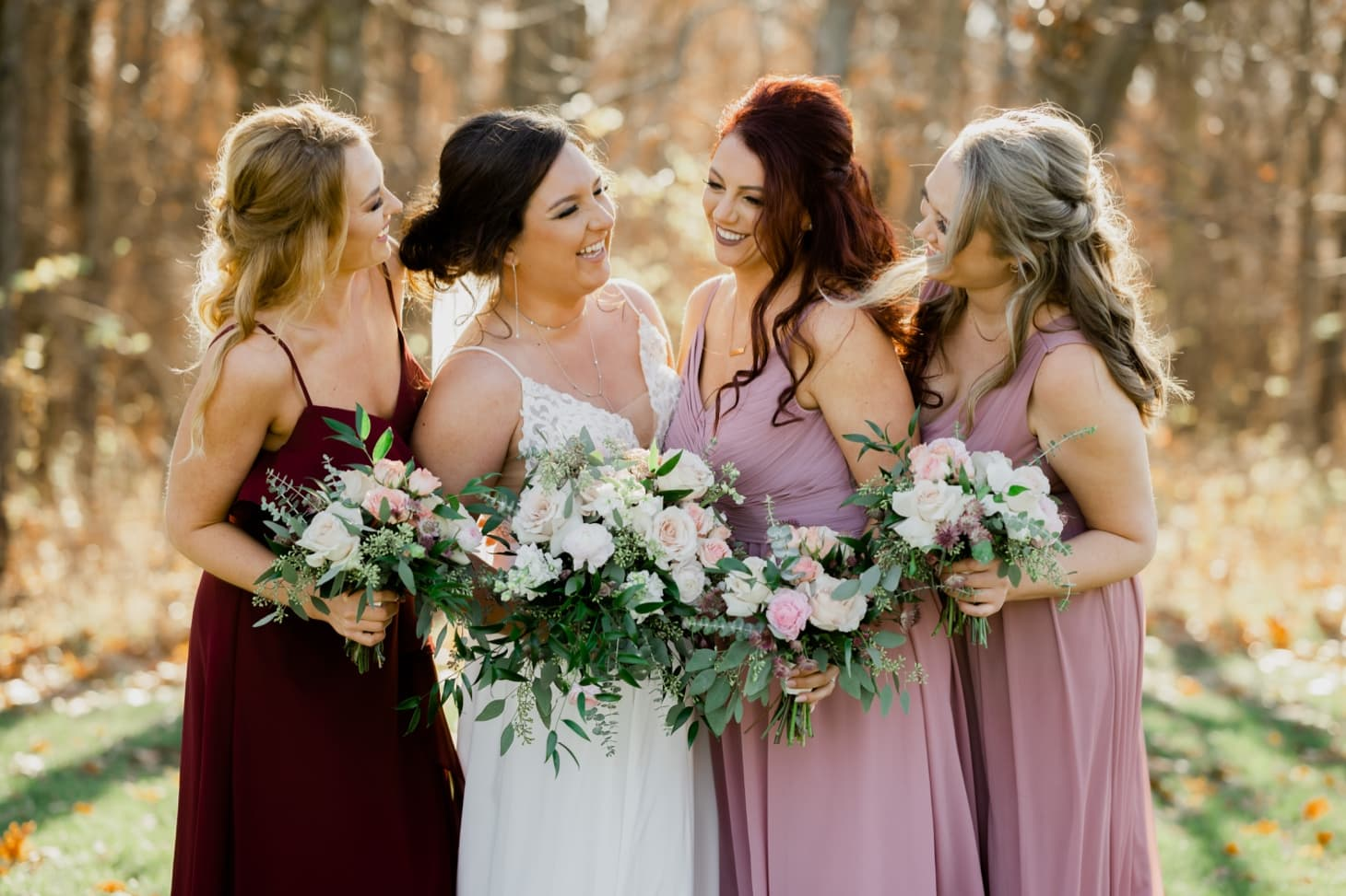bride with bridesmaids at country lane lodge