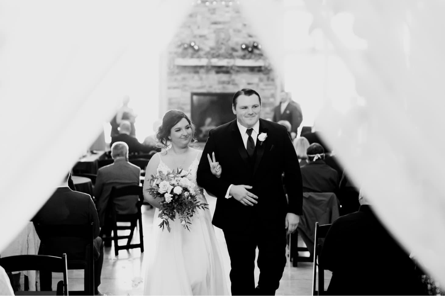 wedding exit at country lane lodge adel iowa