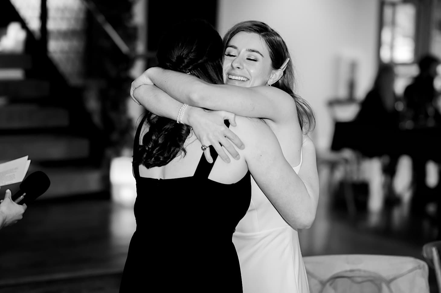 bride with maid of honor river center