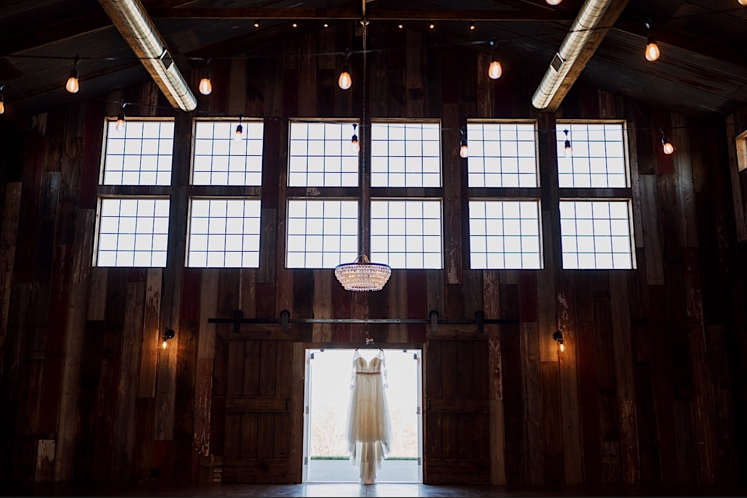 wedding gown hanging at red acre barn