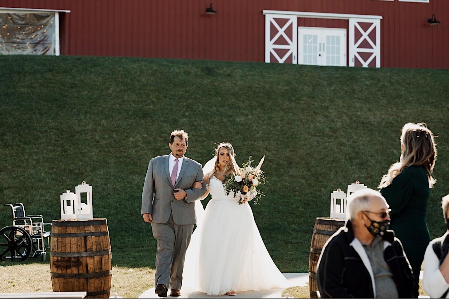 bride walking down aisle Red Acre Barn