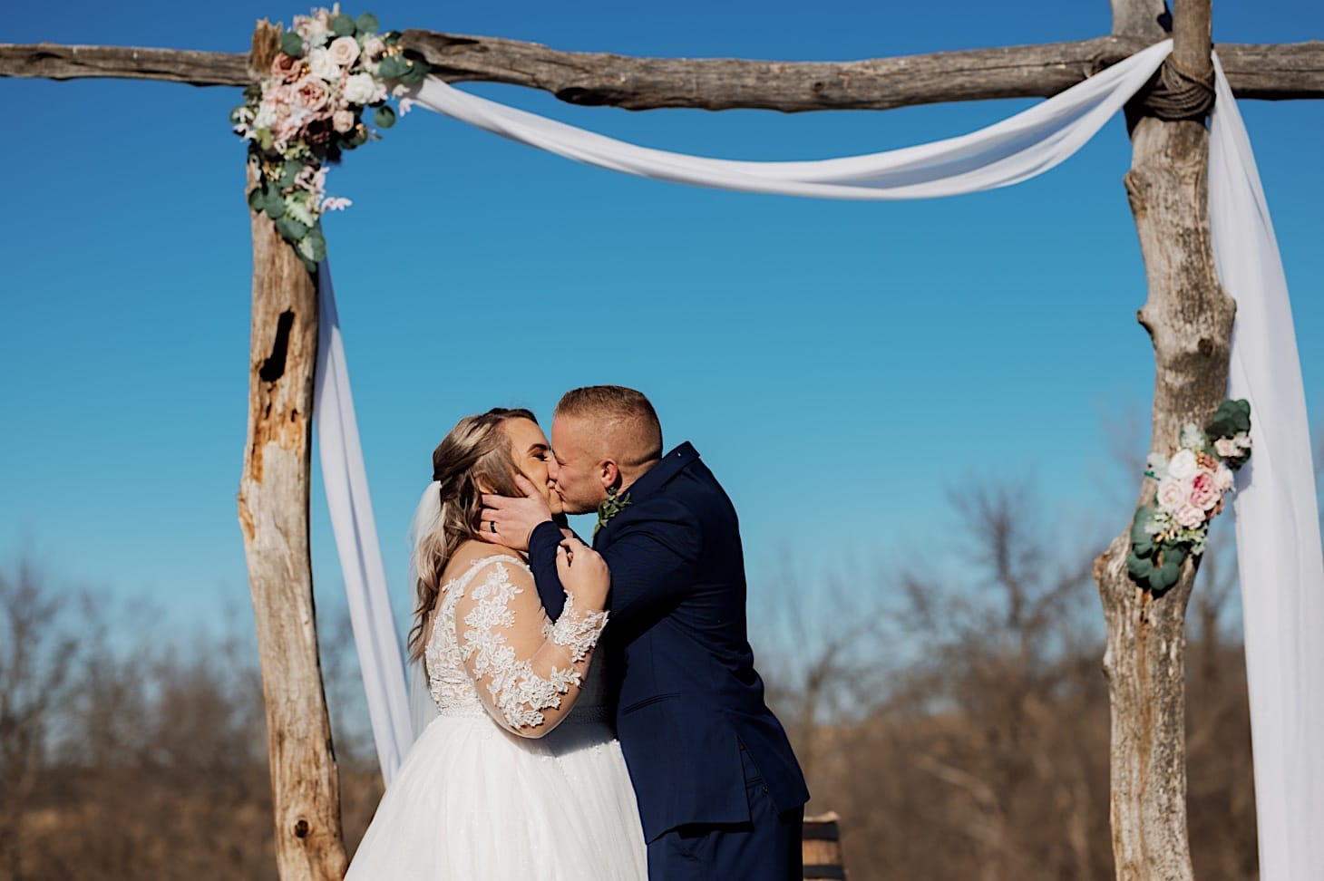 first kiss at Red Acre Barn wedding