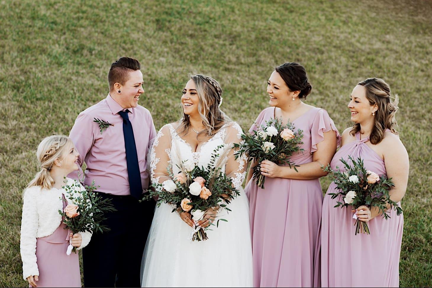 bride with bridesmaids red acre barn
