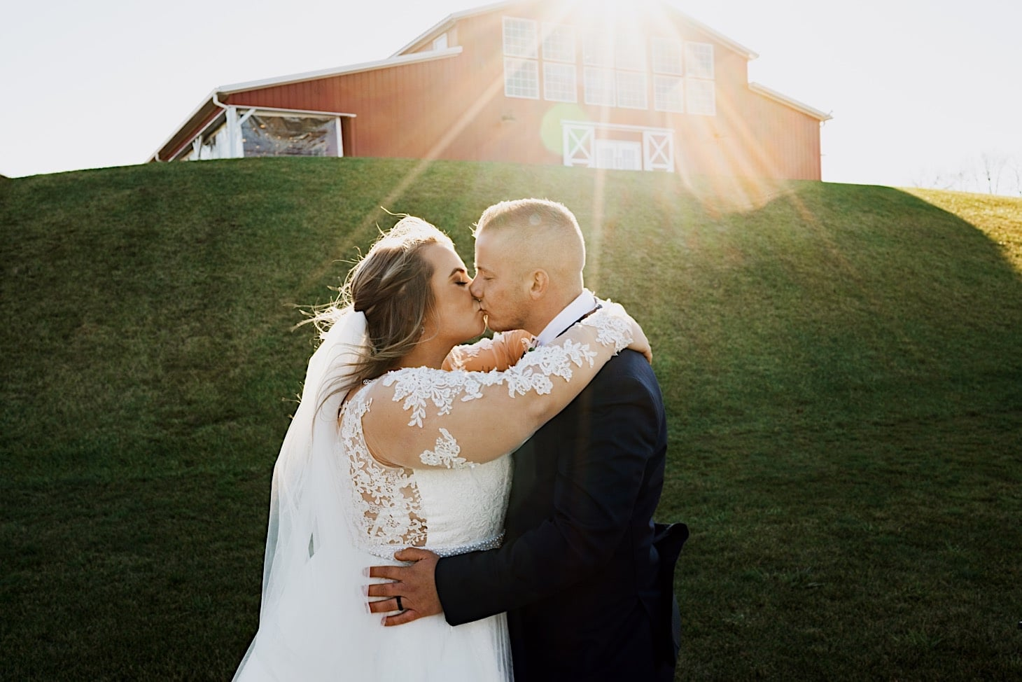 bride and groom photos red acre barn des moines