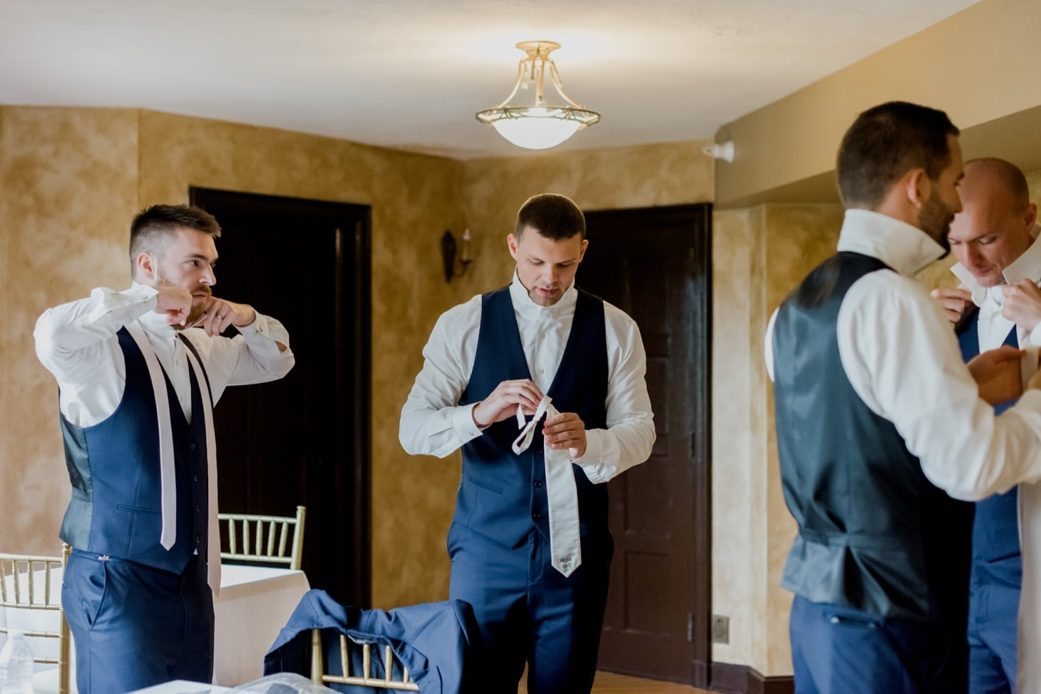 groom getting ready photos rollions mansion des moines