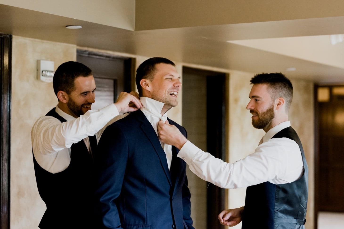 groomsmen getting ready rollins mansion wedding
