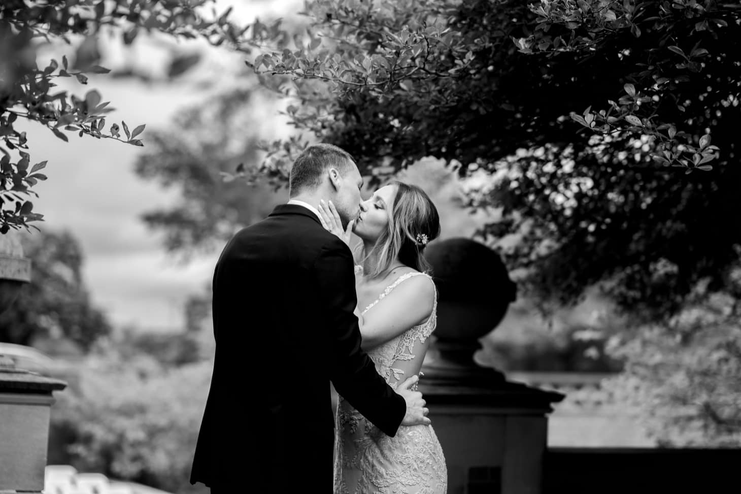 bride and groom kiss rollins mansion des moines