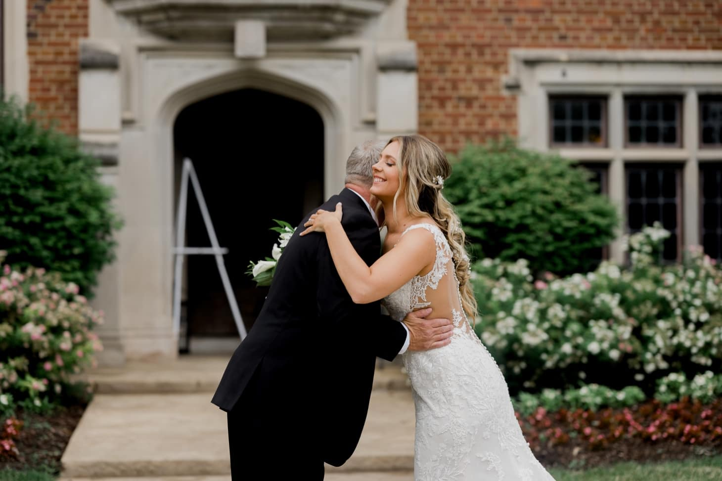 bride first look with dad at rollins mansion