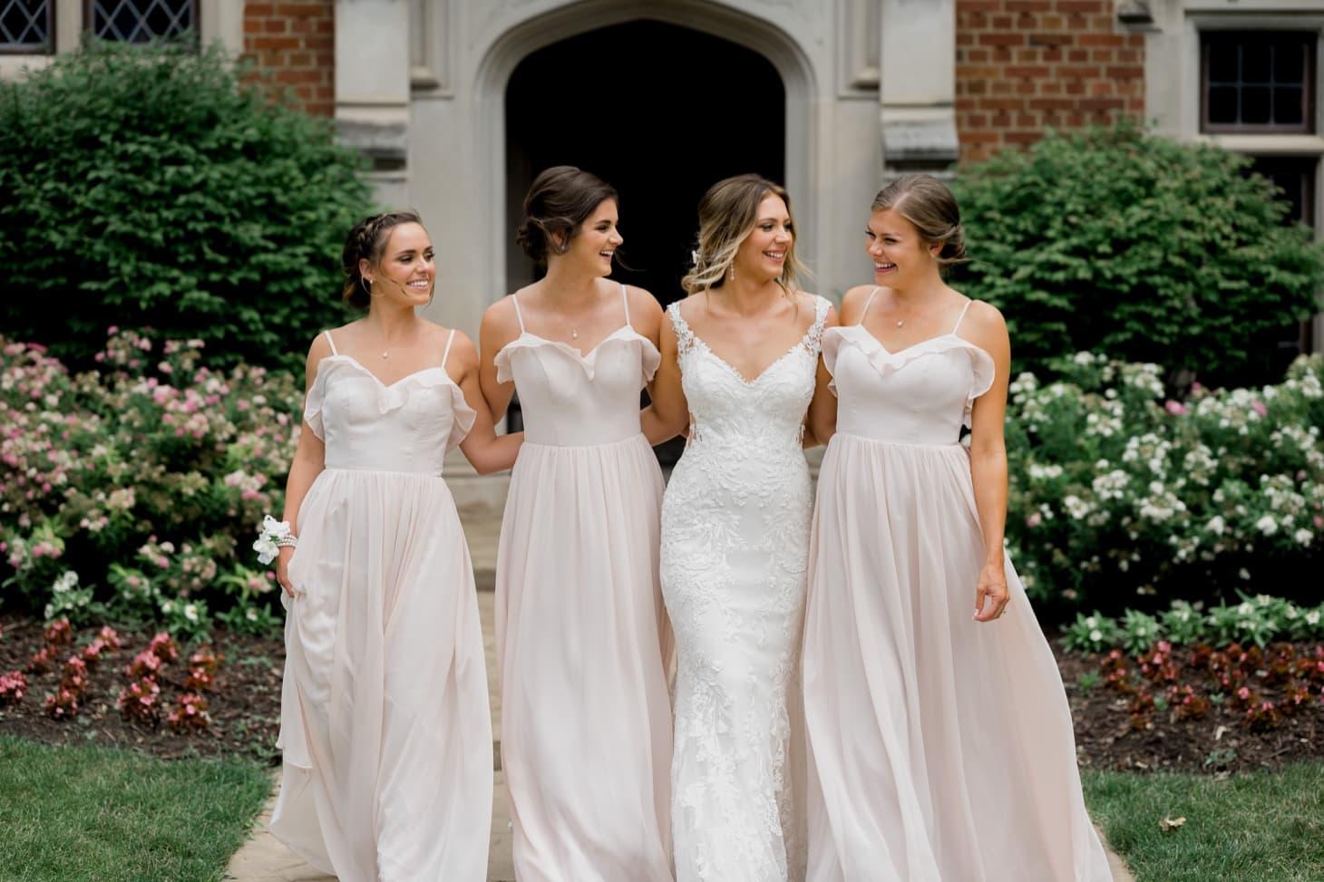 bridesmaids with bride at rollins mansion des moines
