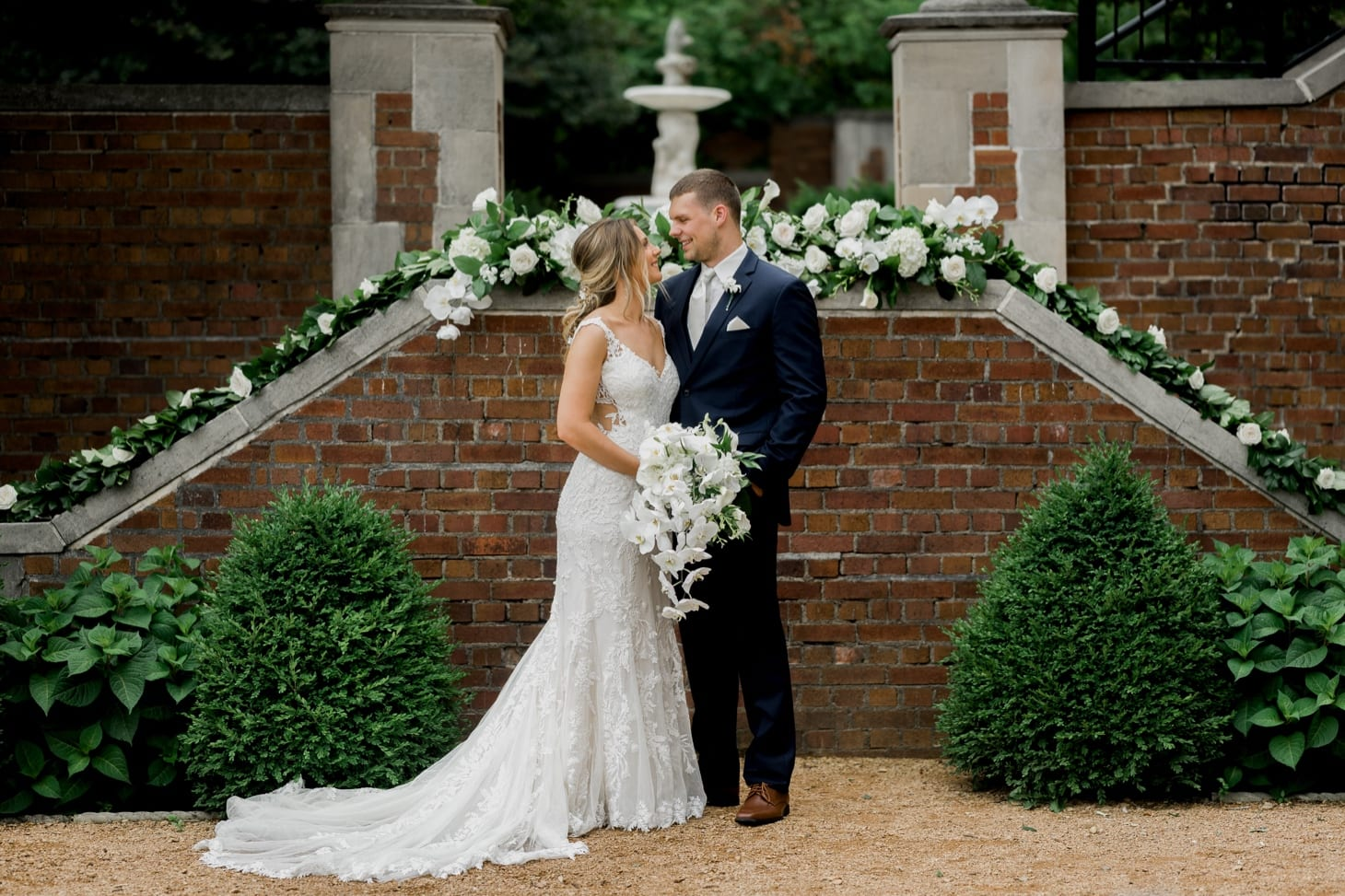bride and groom in front of rollins mansion des moines iowa