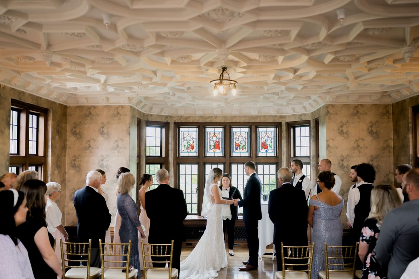 bride and groom at wedding ceremony rollins mansion