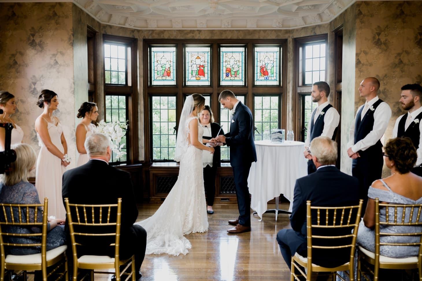 bride and groom vows at rollins mansion wedding des moines
