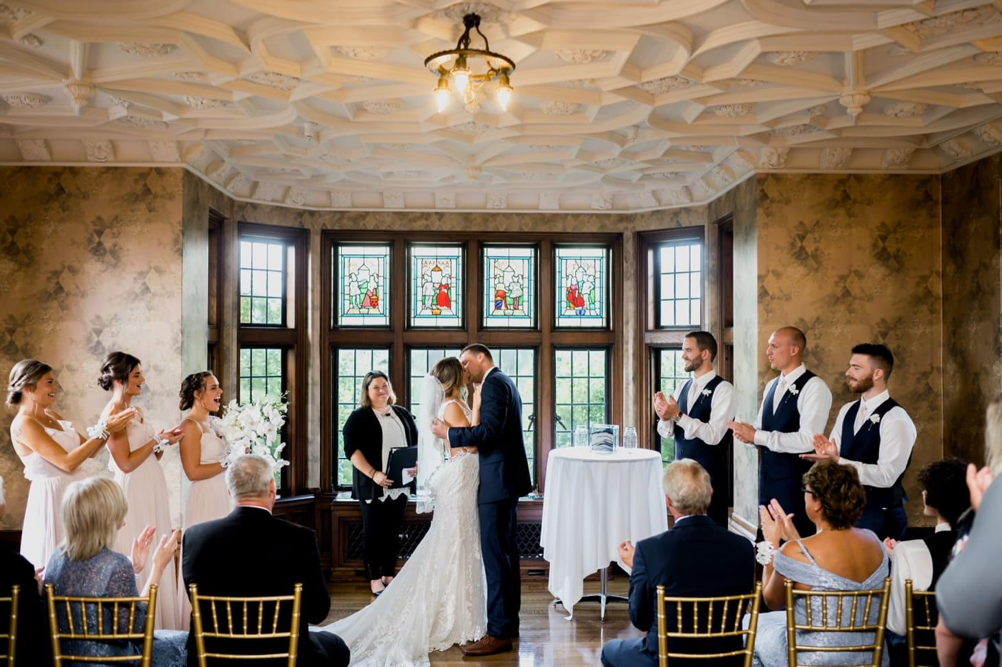 bride and groom first kiss rollins mansion wedding