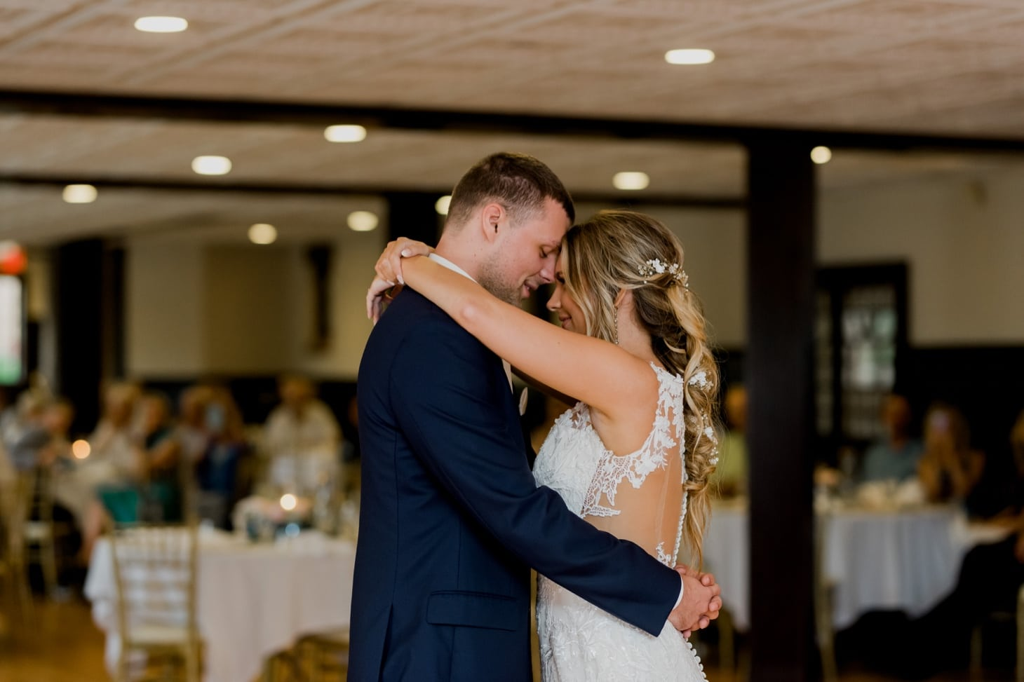 bride and groom first dance at rollins mansion des moines